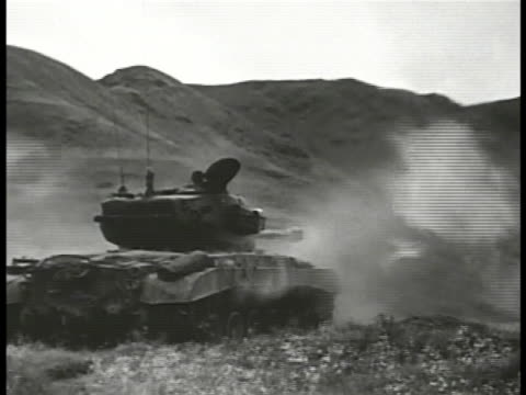 us m26 pershing heavy tank firing another smaller tank firing m26 pershing us heavy tank firing in valley us soldiers of un forces walking up road us... - korean war stock videos & royalty-free footage