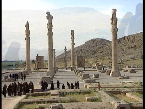 persian treasures to be lent to british museum iran persepolis gv ancient persian ruins iranian tourists wandering around them ms carvings in stone... - persepoli video stock e b–roll