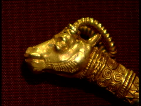 persian treasures to be lent to british museum; reflection of woman's face as she looks as exhibit of persian gold in display case zoom out cms gold... - display cabinet stock videos & royalty-free footage