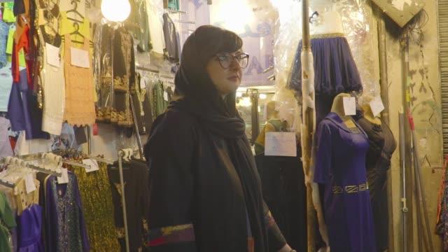 persian woman walks through bazaar - slow motion - teheran stock-videos und b-roll-filmmaterial