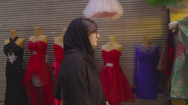 persian woman walks through bazaar - slow motion - hijab stock videos and b-roll footage