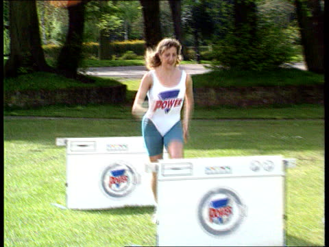 'persil power' problem; tx 29.4.1994 england: london: battersea park: ext sequence sally gunnell jumping over persil hurdles - battersea park stock videos & royalty-free footage