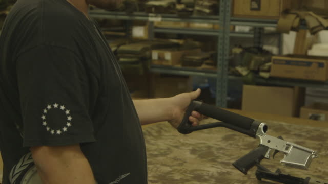 person assembles handmade rifle, montage - gun stock videos & royalty-free footage