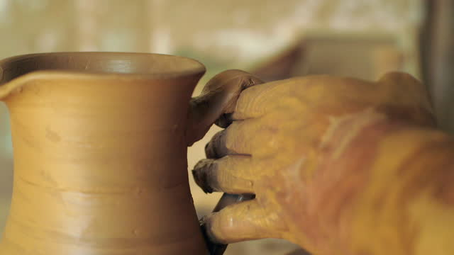 cu person attaches handle to jug in pottery workshop - clay stock videos & royalty-free footage