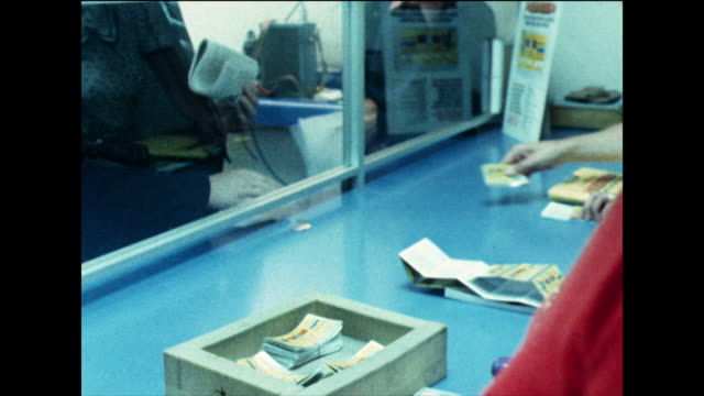 person buys a scratchcard; 1978 - rubble stock-videos und b-roll-filmmaterial