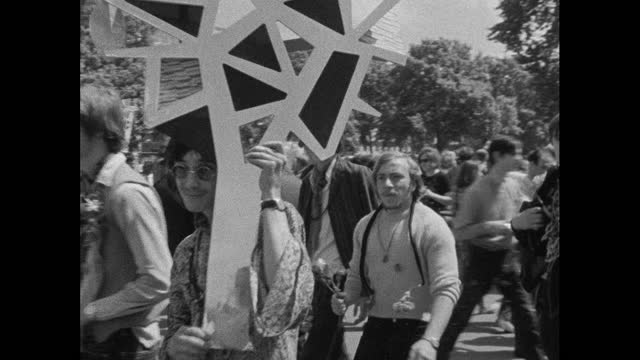 person carries abstract tree art, hippy rally in hyde park, london; 1967 - law stock videos & royalty-free footage