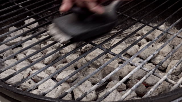 person cleaning a charcoal grill with a wire brush - bbq brush stock videos and b-roll footage
