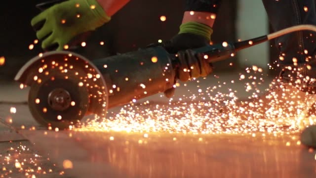 person cutting metal with an angle grinder - sawing stock videos & royalty-free footage