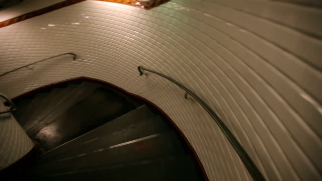 pov person descending spiral staircase in subway station, paris, france - spiral staircase stock videos & royalty-free footage