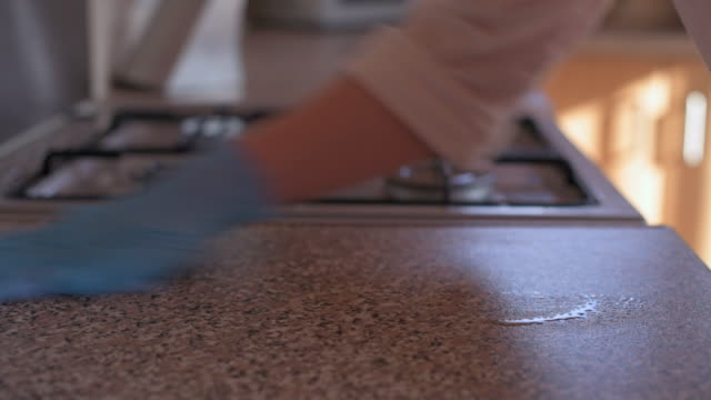 person disinfecting kitchen counters close up 4k - krankheitsverhinderung stock-videos und b-roll-filmmaterial