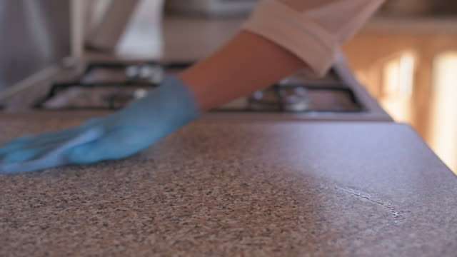 person disinfecting kitchen counters - washing up glove stock videos & royalty-free footage