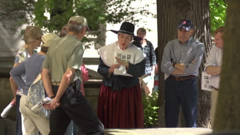 a person dressed as a pilgrim talks to park tourists. - pilgrim stock videos & royalty-free footage