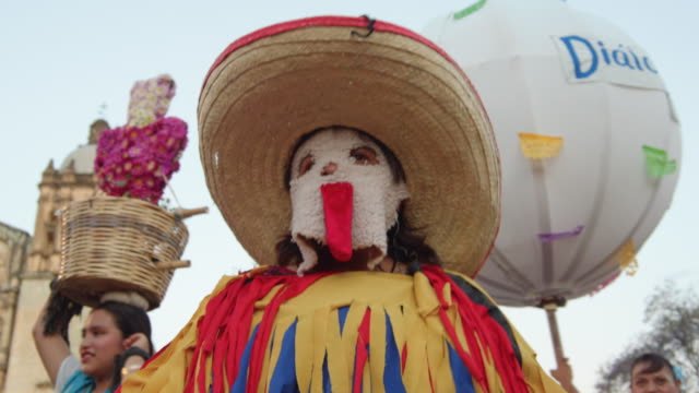 person dressed in a multi colored costume and a sombrero. calendas is a parade and celebration typical from oaxaca, mexico - sombrero stock videos & royalty-free footage
