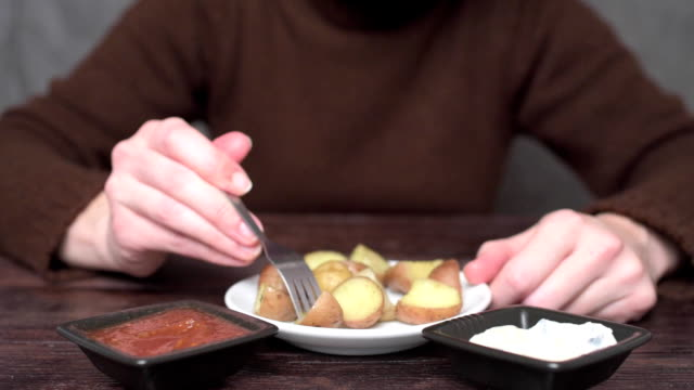 person eating fried potatoes - fried potato stock videos and b-roll footage