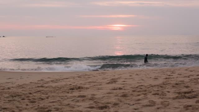 Person enjoying sunset at Toque-Toque Pequeno beach