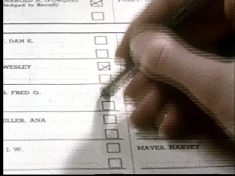 vídeos de stock, filmes e b-roll de cu, person erasing cross from voting ballot - escrita ocidental
