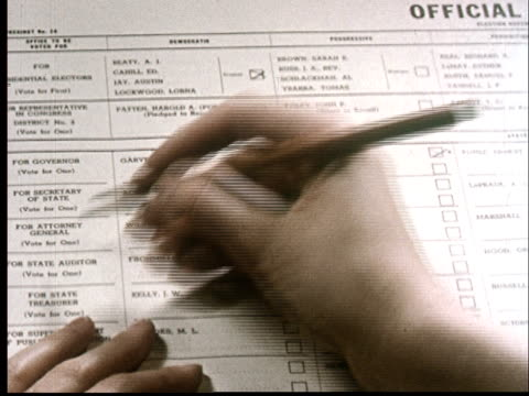 cu, person filling in voting ballot - voting ballot stock videos and b-roll footage