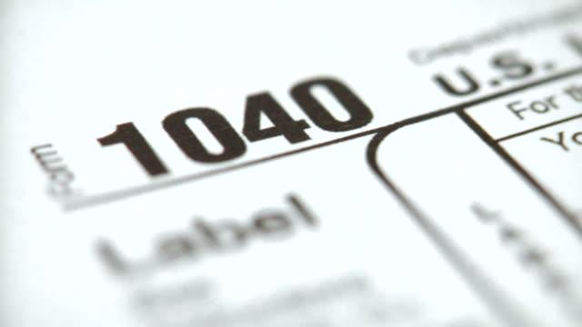 ECU, SELECTIVE FOCUS, Person filling out tax form