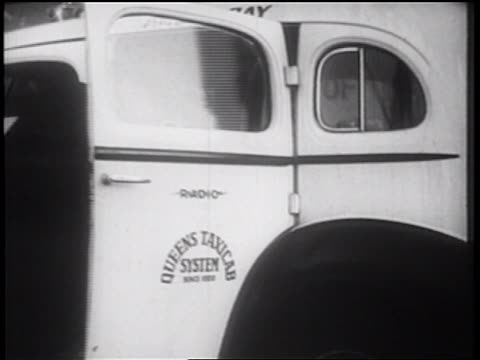 b/w 1939 person getting into queens taxi / nyc / documentary - queens video stock e b–roll