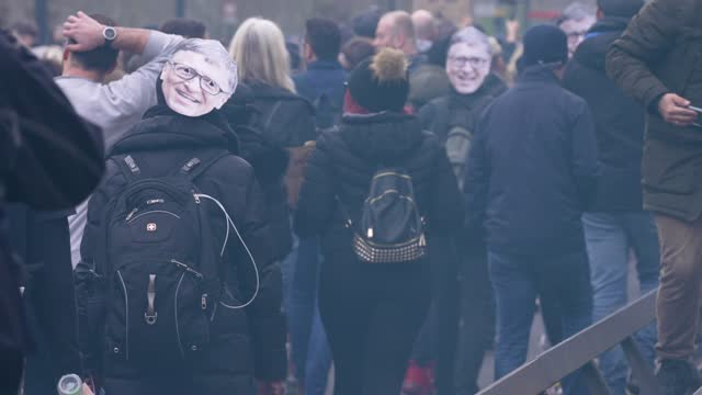 """person has a bill gates face mask on march 20, 2021 in london, england. """"world wide rally for freedom"""" protests, with apparent links to the qanon... - human head stock videos & royalty-free footage"""