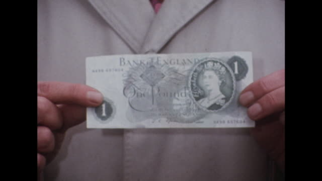 a person holds up a one pound note - financial accessory stock videos and b-roll footage