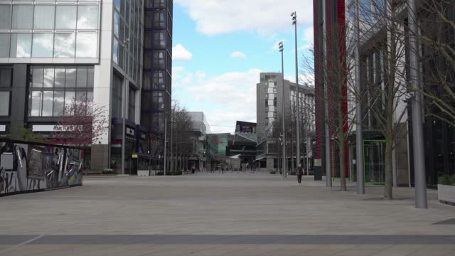 a person in a protective surgical face masks walks through a near deserted westfield shopping centre in stratford during the coronavirus outbreak - diary stock videos & royalty-free footage