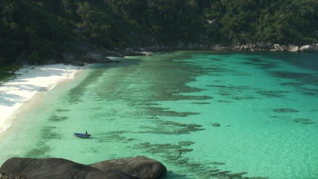 HA WS Person in pontoon boat heading toward beach, Similan Islands, Thailand
