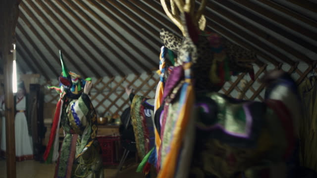 stockvideo's en b-roll-footage met person in traditional tibetan buddhist masks in mongolian ger - northern countryside, mongolia - buddhism