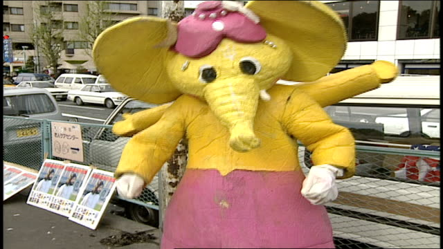 person in yellow four armed elephant costume dancing in harajuku, japan - mascot stock videos & royalty-free footage