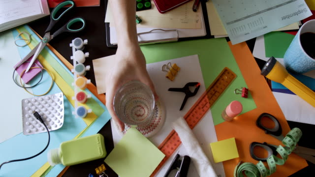 person is working at the messy desktop - pencil sharpener stock videos & royalty-free footage
