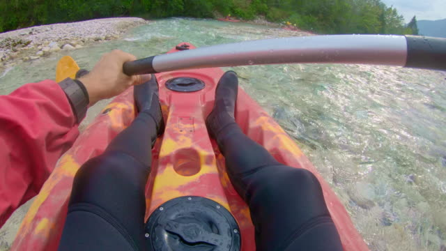 pov person kayaking down the river - rapid stock videos & royalty-free footage