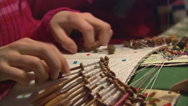 cu pan person knitting and crocheting / gimmelwald, berner oberland, switzerland - berner alpen stock-videos und b-roll-filmmaterial