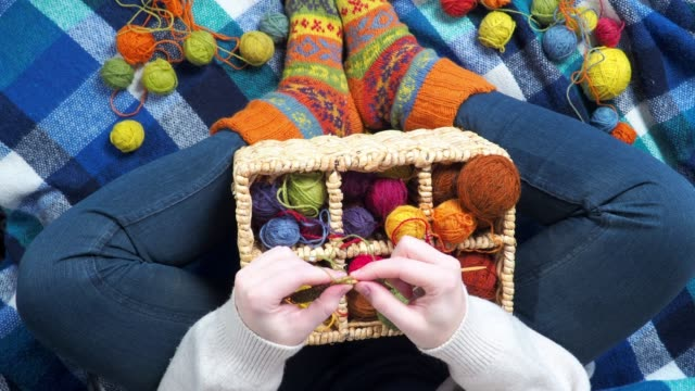 person knitting with colorful balls of wool - wool stock videos & royalty-free footage