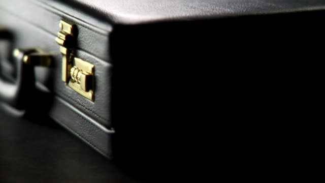 ecu, person locking and unlocking briefcase - briefcase stock videos & royalty-free footage