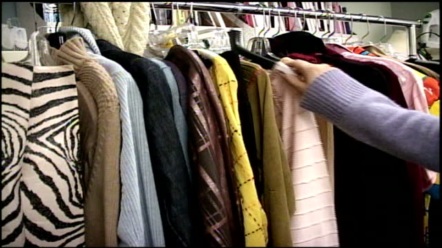 cu person looking through clothes on rack - anno 2002 video stock e b–roll