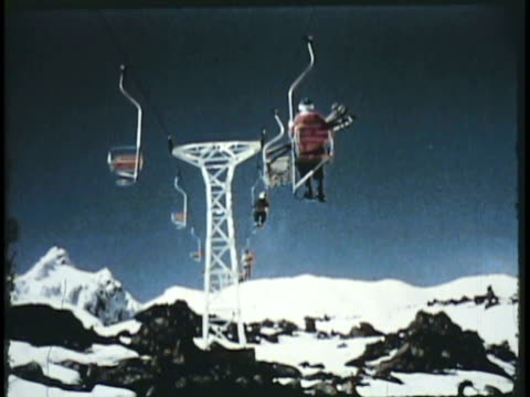 1955 montage ws la td person moving up hill on chair lift, man skiing downhill / new zealand / audio - sci e snowboard video stock e b–roll