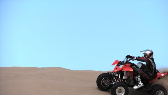 slo mo, ws, person on quad bike riding on sand dune, california, usa - quadbike stock videos & royalty-free footage