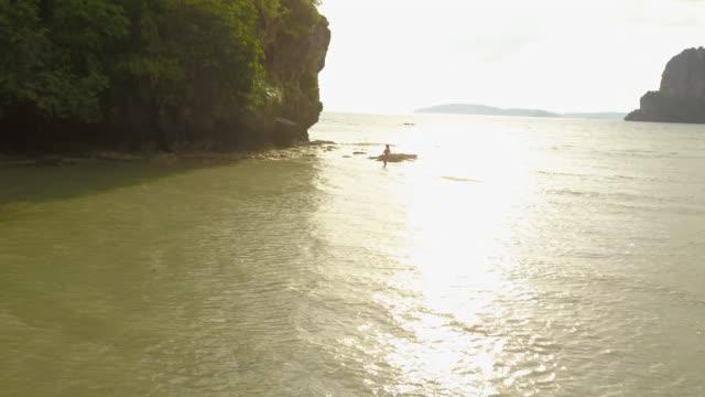 person on thailand coast at sunset, aerial - クラビ県点の映像素材/bロール