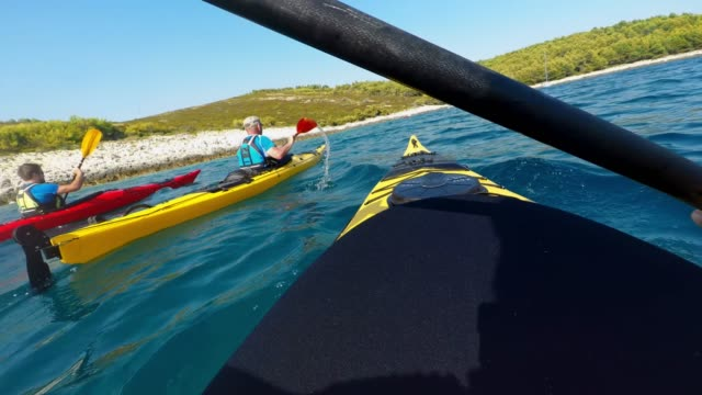 pov person paddling with friends at sea on a sunny day - using a paddle stock videos & royalty-free footage