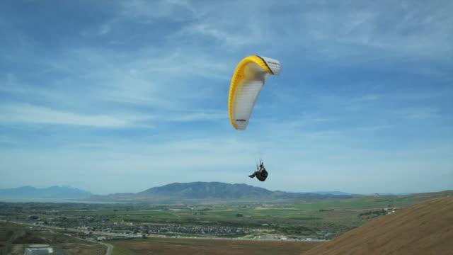 ws pan pov person paragliding mid-air / lehi, utah, usa. - lehi stock videos & royalty-free footage