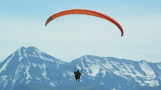ws pan pov person paragliding over mountain / lehi, utah, usa. - lehi stock videos & royalty-free footage