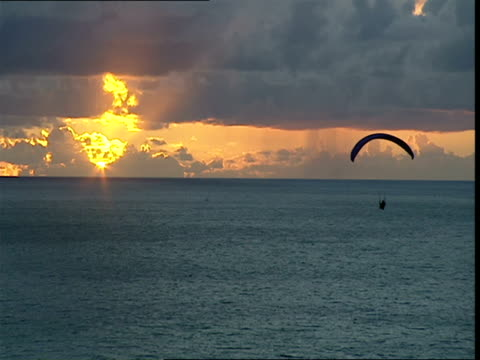 ws,  pan,  person paragliding over ocean at sunset,  san diego,  california,  usa - paragliding stock videos & royalty-free footage