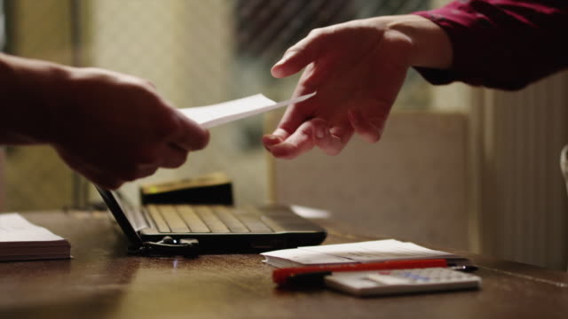 CU Person paying with credit card at tailor's shop, close-up of hands / Provo,Utah,USA