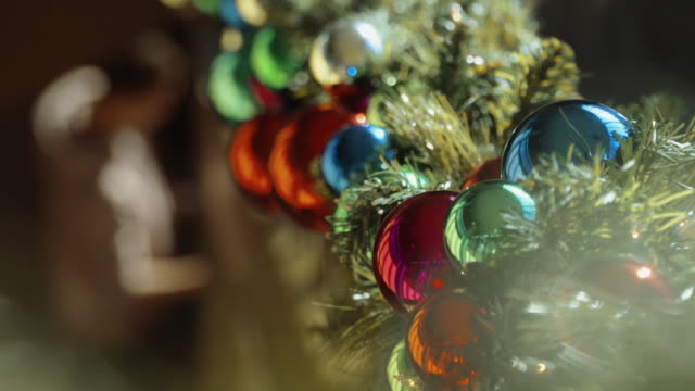 Person Placing Christmas Decorations Shallow DOF