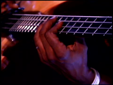 person playing bass guitar - bass guitar stock videos & royalty-free footage