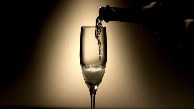 CU SLO MO Person pouring Champagne into flute / Burbank, California, USA