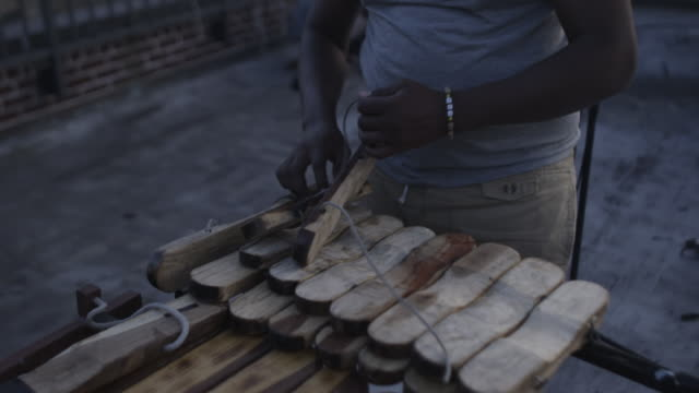 person prepares homemade marimba - untied stock videos and b-roll footage
