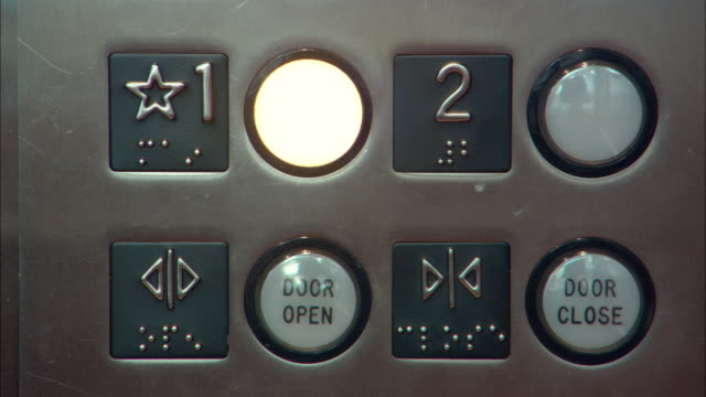 ecu person pressing elevator button, los angeles, california, usa - spingere video stock e b–roll