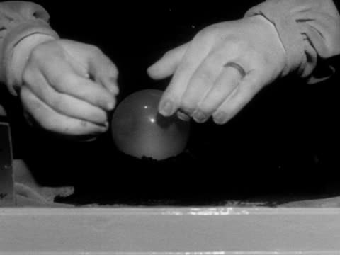 a person puts a coin into a fortune telling machine on brighton's palace pier - crystal ball stock videos & royalty-free footage