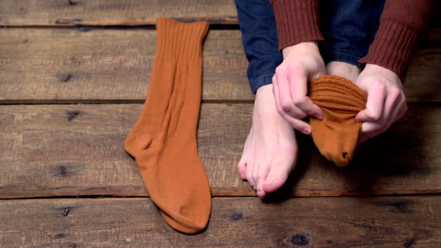 person putting on socks - man made object stock videos & royalty-free footage